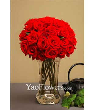 Two Dozen Red Roses With a Vase