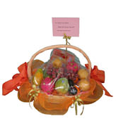 A basket of fruits for the Mid-Autumn Festival, includes red grape, golden pear,apple,one single yolk mooncake an so on.