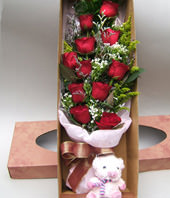 11 Red roses and A bear