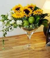 Cheery Sunflowers, Fragrant Freesias And 2 Green Apples In A Cok