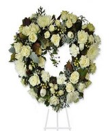 18 inches heart shaped,white roses,white daisies,white spider mums.Easel not included.