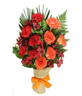 Mix of fresh blooms in reds and oranges