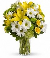 yellow roses, lilies and other bright blooms