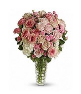Bouquet of light pink roses, pink roses, creme roses, pink spray roses and variegated pittosporum