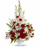 arrangement of red and white roses, oriental lilies, carnations and more