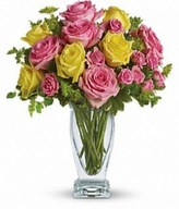 Yellow and light pink roses, pink spray roses and fresh greenery. Approximately 13