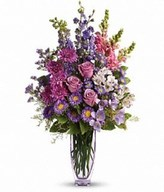 Lovely lavender roses, alstroemeria, larkspur, freesia, matsumoto asters and limonium are joined by light pink snapdragons, purple monte cassino asters and statice.