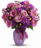 Lavender roses and daisy chrysanthemums, purple carnations, miniature carnations, asters and pink waxflower