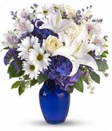 creme roses, white lilies and alstroemeria along with yellow and white chrysanthemums, eucalyptus, limonium and more