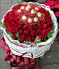 50 red roses and Ferrero Rocher 12 yarn packages . White flowers