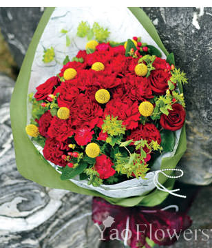 Red carnations, dragon fruit , cockscomb, roses