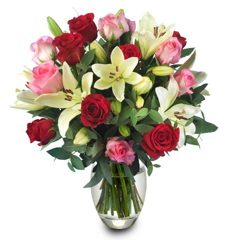 A Perfect Touch: 12 roses & 3 lilies (Vase included)