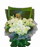 20 white lisianthus,1 bear