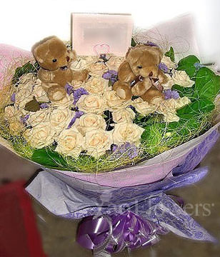 33 champagne roses ,lavenders ,two bears