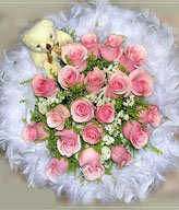 15 pink roses ,prunus ssioris , goldenrods and a cute bear