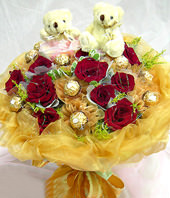 10 Red roses,chocolate flowers,A pair of bear