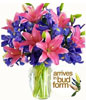 4 multiple-bloom stems pink Asiatic lilies 10 blue iris in Glass Vase