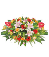 Table Basket -  Anthurium, Pink Lily , red sunflowers , champagne roses , pink long carnations , green leafy