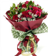 19 red roses, a small amount of peach carnations off Lacy and green leaves with