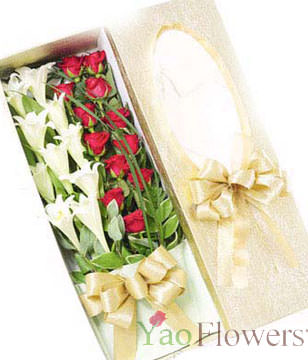 9 Lilies ,12 Red roses in a cute box