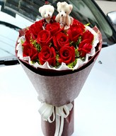 19 Red roses with a pair of bear