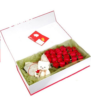 33 red roses, A plush bear