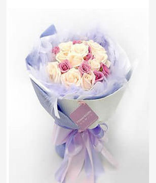 A bouquet of 15 champagne roses and 10 purple or red or pink roses