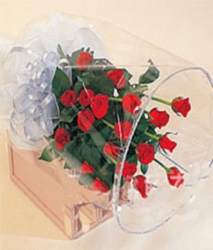 A bouquet of 20 red roses with green foliages
