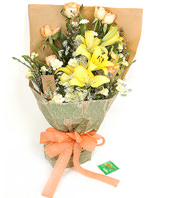 3 yellow lilies,6 champagne roses and 6 yellow carnations