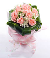 18 Pink roses with greenery with pink paper wrapping