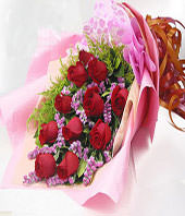 A bouquet of 11 red roses with green foliages