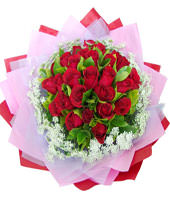 A bouquet of 22 red roses with green foliages