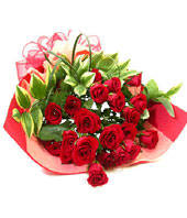 21 red roses with some gardenia and aspidistra