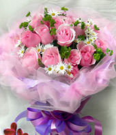 19 pink roses with some gardenia and aspidistra