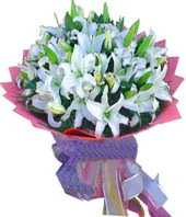 A bouquet of 11 white lilies with green foliages