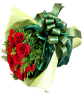 A bouquet of 12 red roses with green foliages