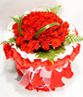 33 red roses with some gardenia and aspidistra wrapped by white inner and red outer circular paper