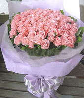 A bouquet of 99 pink roses with green foliages