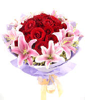 33 red roses with 11 pink lilies around