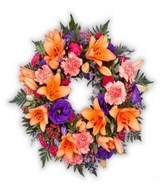 Traditional, colorful wreath of funeral flowers