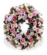 Gentle circular wreath of pastel pinks and creams.