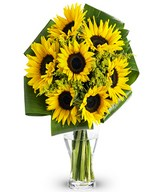 Yellow sunflowers mixed with Solidago and assorted greenery