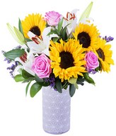 Sunflowers, pink roses, white oriental lilies and limonium with greenery