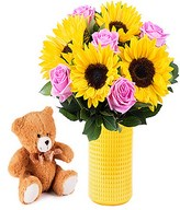Sunflowers, pink roses and teddy bear