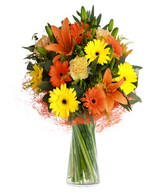 Lilies, solidago, carnations, and gerberas.