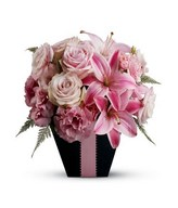Pink roses, pink carnations, and pink lilies arrangement