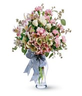 Vase arrangement of carnations, lilies and roses