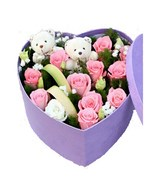 12 pink roses with babybreath, and 2 cute bears arranged in a heart shape box