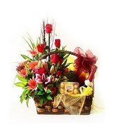 Basket Arrangement of Mixed Flowers with Ferrero Rocher Chocolate & Bottle of Sparkling Juice with Mixed Fruits