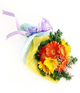 Orange and yellow gerberas with filler in a bouquet